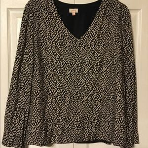 Black and beige v-neck blouse with bell sleeves
